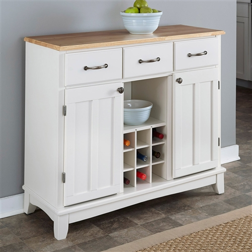 A great combination of elegance and function, this Natural Wood Top Kitchen Island Sideboard Cabinet Wine Rack in White keeps your kitchen organized while making optimum use of your space. Made from quality hardwood and wood products, it has three utility drawers and two one-door cabinets with an adjustable shelf for plenty of storage. The wine storage area at the center can be removed for open storage if desired. The server base is available in a selection of finishes while the top comes in 18-gauge stainless steel or in a choice of wood finishes.