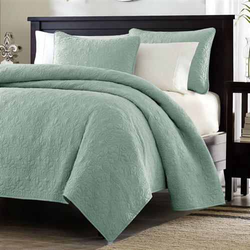 This Twin / Twin XL size Coverlet Quilt Set with Sham in Seafoam Blue Green Brushed Fabric is the perfect coverlet to use as a layering piece or an alternative to your comforter for a new solid look. The classic stitch pattern pairs easily with your existing décor and will sure to add a new decorative element to your bedroom. The coverlet has 100% cotton fill and the face and the reverse of the coverlet are a super soft brushed fabric. Material: Microsuede; Polyester; Pieces Included (Twin / Twin XL Size): 1 Coverlet, 1 Standard Sham.