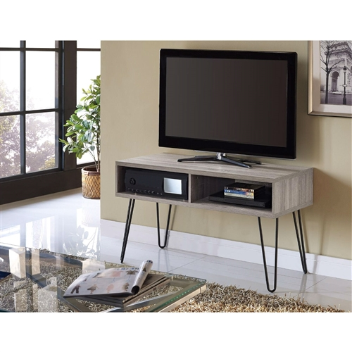 "Simplify your TV room with the attractive, designer look of this Modern TV Stand in Oak Finish with Mid-Century Style Metal Legs. Perfect for a variety of interiors, from sleek contemporary spaces to casual transitional décor, this TV Stand creates a stunning showcase for your television. TV Stand features a light Sonoma Oak finish on top of Gunmetal Gray legs in a retro hairpin style. The large top of this TV Stand accommodates up to a 42"" flat panel TV. Two open cubbies offer room for your cable box, DVD player or gaming system."