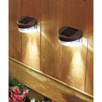 "Set of 2 Solar Fence Lights with LED lights and Ni-Cd battery, SFLSO2 :  Solar Fence Light, Set of 2 Designed for wooden fences, this Set of 2 Solar Fence Lights with LED lights and Ni-Cd battery features extra-bright LEDs charged with solar power. Measuring 4-1/2"" x 3"" x 2-1/4"", each bolts right on the fence for quick mounting. At dusk, they automatically come on. No wiring required. The solar panel on top uses the power of the sun to provide eco-friendly energy for the light. Includes on/off switch. 4-1/2"" x 3"" x 2-1/4"", each. Plastic. For accent lighting or general illumination! Order several sets to light an entire fence! 2 Super-bright LED bulbs in each light Details: Plastic 4-1/2"" x 3"" x 2-1/4"" Solar powered."