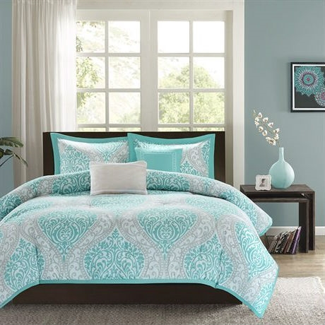 This Full / Queen Teal Turquoise Aqua Blue and White Damask Comforter Set is the perfect way to make a fashion statement in your bedroom. The vibrant aqua and grey damask print adds a pop of color to this comforter. Two embroidered decorative pillows are included in this comforter set for a finished look. Comforter/Sham: 100% polyester peach skin, printed, 100% brushed polyester reverse, 200g polyester filling Pillow: polyester cover and polyester filling.