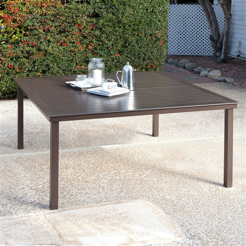 Square 60-inch Contemporary Mocha Brown Patio Dining Table, CSAMB5198415 :  When it comes down to you and this Square 60-inch Contemporary Mocha Brown Patio Dining Table, only one of you doesn't mind standing out in the rain. The all-weather, corrosion-proof aluminum body of this slat-top table is designed to love the outdoors in all climates. The slat-top makes it easy to clean, and the modern design will be a perfect accent to your outdoor environment. Material Aluminum; Seating 8 Person; Style Poolside Tables.