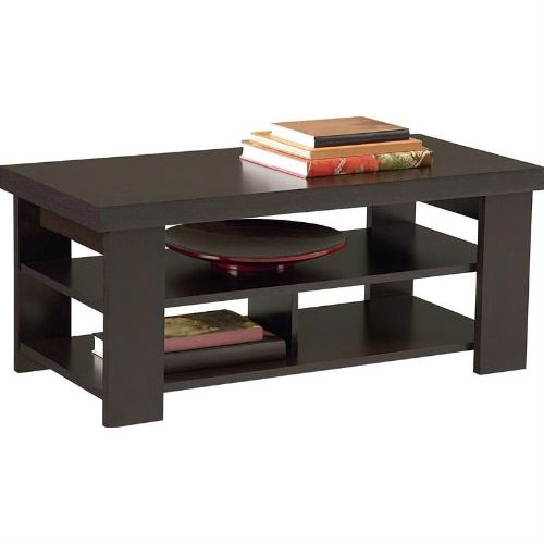 This Modern Coffee Table in Dark Brown Black Forest Finish has a stylish contemporary design to compliment any décor in the home. It has a maximum capacity of 100 lbs. on the top shelf, 100 lbs. on the middle shelf, and 50 lbs. on each side of the bottom shelf. It's easy to assemble with household tools.