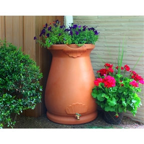 2-in-1 Terra Cotta 65-Gallon Rain Barrel Urn and Planter, GIRW65GUP129 :  This 2-in-1 Terra Cotta 65-Gallon Rain Barrel Urn and Planter is a thing of beauty and clever design. Constructed with thick and durable polyethylene resin which holds up to the harshest elements, the exterior has the appearance of a terra cotta urn. The graceful lines, curves, and garnishes on the exterior make it an accent peace on your home's exterior and not something that just sticks to your house. The flat back design optimizes space used and allows you to position the barrel close to walls or flat areas. The top is the only of its kind that not only acts as a planter space, but also features a unique watering system that leeches excess water from the barrel itself. There is also a channel built into the rim which diverts overflowing water to the front and away from the barrel and home foundation. You can have peace of mind that you're helping the environment by conserving water and giving your garden the best water it can get, devoid of harsh chemicals and rich in nutrients. And you can perform that conservation without sacrificing your home's outer appearance with the very stylish and functional Rain Wizard Urn.   Urn shape and color add class and style to your rain harvesting; Meshed screen blocks debris from entering your water supply; Flat back design sits tightly against any outside wall; Equipped with a sturdy brass spigot which won't rust or break like plastic alternatives; Routed channel diverts excess water to the front of the barrel to avoid flooding your foundation; Linkable to all other Rain Wizard rain barrels.