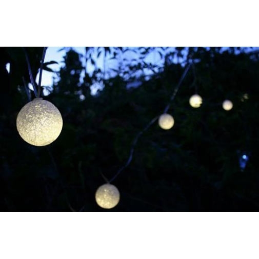 "Set of 12 - Solar String Luminous Glow Lights,  SSL12P1 : This Set of 12 - Solar String Luminous Glow Lights is among our best looking outdoor lighting products. The set of twelve (12), 2.1"" (7cm) spheres are made of a durable off-white textured EVA material that looks charming when hung along shrubs, branches, trellises and garden areas. At dusk, the spheres glow warmly with a rich yellowish light that adds elegance to any surroundings. The generous 18"" spacing between spheres permits the string to cover a 16' distance. There's additional 7.6' length of wire between the solar panel and first sphere to permit locating the solar panel in the best location for optimum sun, using either the ground stake or included building/post attachment kit. The solar panel uses a high quality amorphous type panel and an internal 300mA lithium battery to provide many hours of illumination. Fully waterproof, the panel and spheres look great when placed in trees, along fences or gates, from a trellis or anywhere you're adding atmosphere and elegance to an outdoor space. Powered by the sun, the lamps illuminate automatically at dusk. With good sun exposure, expect 8 hours of illumination or more, as performance is directly related to the amount of sunshine received (summer sun results in the lamps glowing for over 10 or 12 hours). We love our Luminous Glow Solar Strings and know you will too. See all our solar products on our Amazon store! (Note: We're 110% committed to providing quality products. We now include a spare 3.2V rechargeable battery with each light string to ensure the lamps exceed your expectations). Powered by a compact solar panel that can be ground mounted or attached to a nearby tree, post or building"
