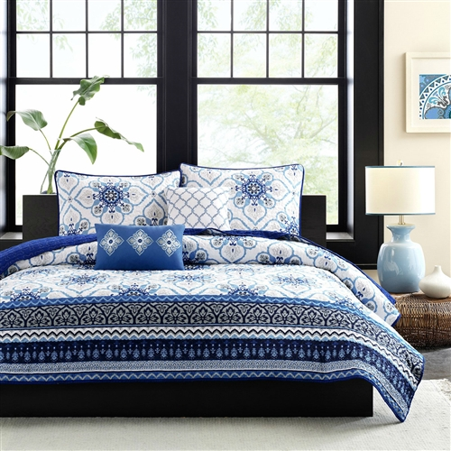 The Full / Queen size Blue White Floral Lightweight Coverlet Set will bring an elegant look to your bedroom. Varying blue and gray prints run along the bottom, and a dark blue border outlines the coverlet creating dimension and depth. Made from polyester and a cotton filling, this coverlet is machine washable for easy care. Two white and blue decorative pillows with embroidered details complete the look.