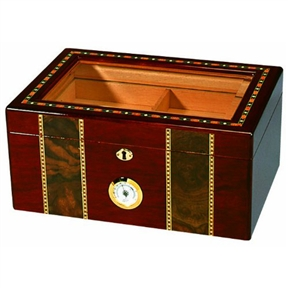 Elaborate 100 Cigar Tempered Beveled Glass Top Humidor in Cherry, QIP100CGH108 :  This Elaborate 100 Cigar Tempered Beveled Glass Top Humidor in Cherry has a striking, impactful design that makes a stunning presentation. The tempered beveled glass top allows for display, while an integrated front-mounted hygrometer provides easy monitoring. Opens and closes smoothly on hidden quadrant hinges. Features gold plated lock and key with tassel, engraveable brass nameplate. 1 large rectangle humidifier in spanish cedar holder; Spanish cedar tray with divider and 2 dividers at bottom; Rich high gloss cherry finish with elaborate multi-wooden inlay.