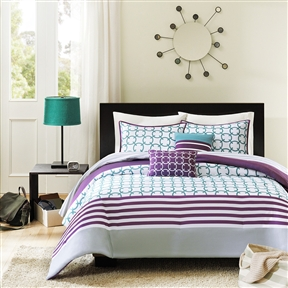 This Full/Queen 5-Piece Comforter Set in Purple White Teal Circles & Stripes brings youth and vibrancy to your bedroom with a teal and white checkered print and horizontal purple stripes. A gray stripe runs along the bottom of the comforter. The reverse is covered in a more subtle gray and white striped print. Made from polyester this comforter is machine washable for easy care. Includes two decorative teal and white pillows. Machine wash cold, gentle cycle, and separately. Do not bleach. Tumble dry low, remove promptly, do not iron. If there is no free movement in the washer or dryer, use large capacity commercial washer/dryer. Material: Polyester; Reverse: Brushed polyester; Pattern: Gingham. Color: Teal; Country of Manufacture: China.
