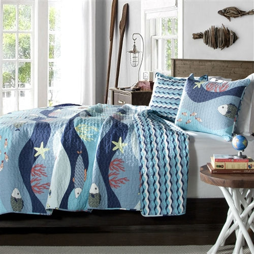 Come and dive into the magic world of sea life surrounded with fish, reefs, and colorful ocean floor. The face of the comforter adds fun to the décor with its print details while reverse of the comforter adds serenity with wave pattern in the shades of blue and white. Made from 100% cotton, this set is soft to the hand and has wonderful quilting details.