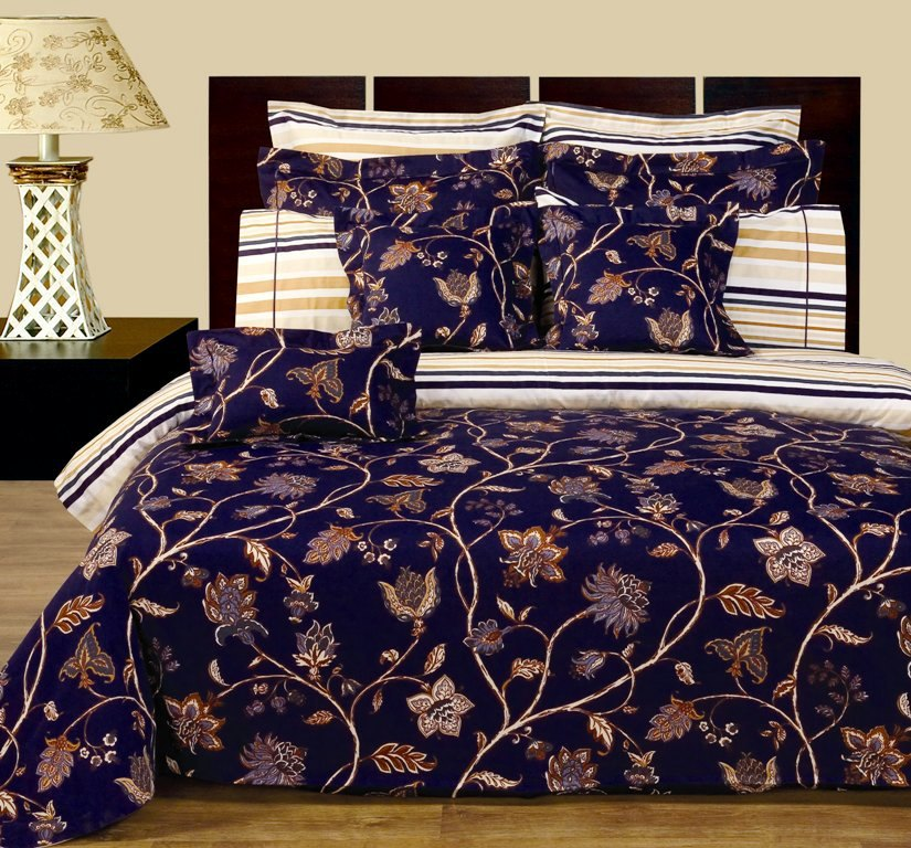 """Lilian Reversible Multi-Piece Bedding Set. Experience the luxurious soft 100% Egyptian cotton Lilian Bedding made with 400 Thread count per squire inch. Luxury and Fashion were combined in this 12 pieces Two-Look bedding set. The soft touch and ware of Egyptian cotton fabric was printed with updated flowery / contemporary type of look.   This is a Two-Look kind of Set, the front has one print and the back has another print. The duvet cover and all Shams are made with two prints. Making or changing the look of you bed room would take no more than few second, just turn the duvet cover and pillow shams up side down and you have totally new look for your bed.The front print has Navy blue back-round, while the back or other side and the sheets have multiple color stripes printed. This Luxury Lilian bed in a bag ensemble includes: One duvet cover reversible, two pillow shams reversible, two Euro shams reversible, one Fitted sheet with 16"""" pockets, two pillow cases, two decorative pillows shams 16x16"""", one decorative breakfast shams 10x16"""""""