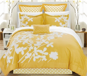 Queen size Yellow 7-Piece Floral Bed in a Bag Comforter Set. Elegant floral design reversible comforter set done over a panel printing like a photo frame. Enjoy this large scale print, which will make your bed feel like a real life garden. Reversible contrast print allows you to switch your bedroom decor at a glance. Luxury decorative pillow included. Elegant floral, reversible comforter, Bed skirt, shams, decorative pillow. Set includes: 1 reversible comforter, 1 Bed skirt, 2 shams, 2 euro shams, 1 decorative pillow.