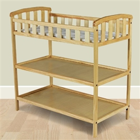 """This Natural Finish Wood Baby Furniture Changing Table with Safety Rail allows any parent to change their baby with comfort and ease. Featuring a 1"""" changing pad keeping baby happy and comfortable and 5 ½"""" safety rail that surrounds your baby with security so they don't roll off the table . The open design featuring 2 shelves below keeps all your baby's essentials close and convenient. With a great traditional design this crib fits perfectly into any decor."""