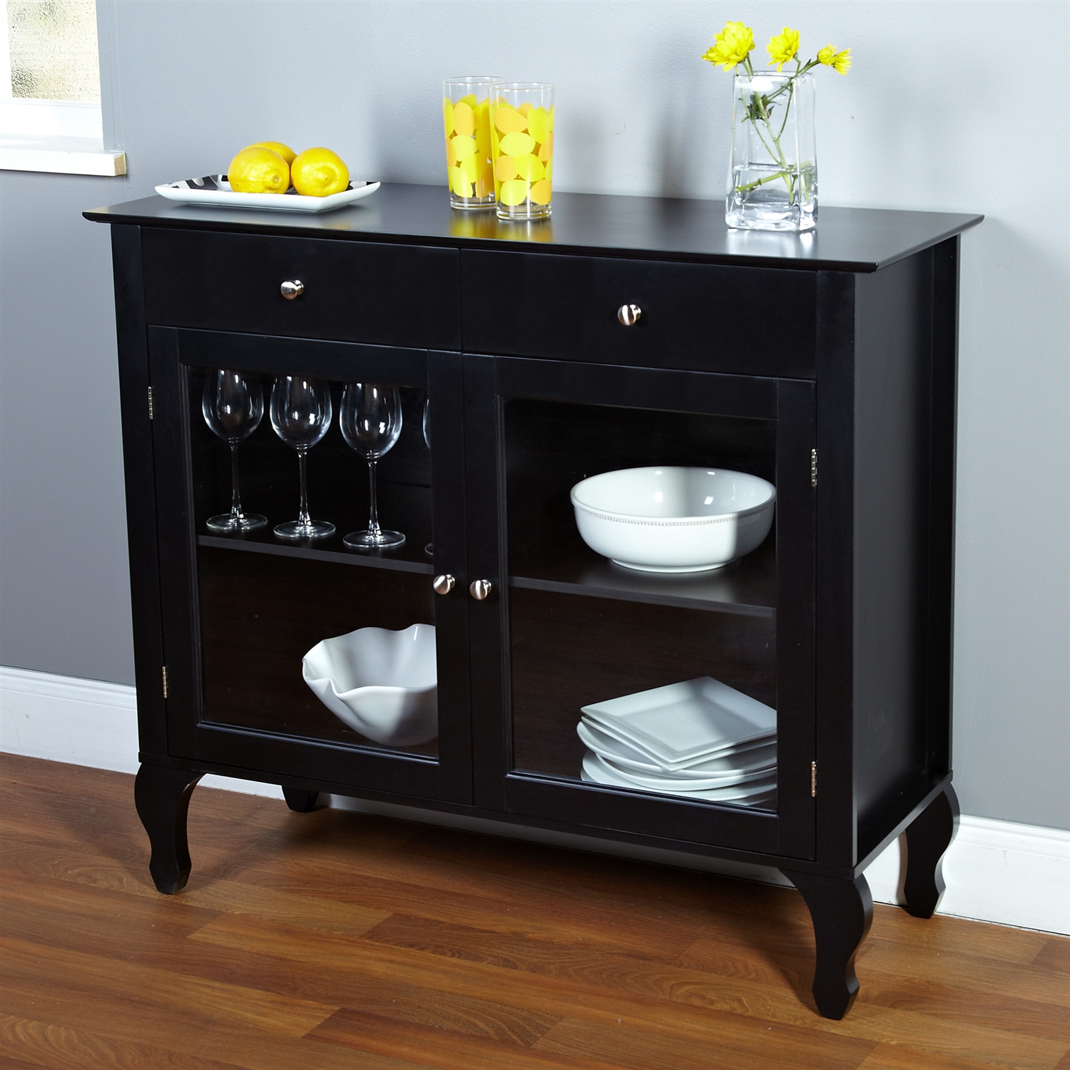 Complete the look of your living space with this Black Dining Room Buffet Sideboard Server Cabinet with Glass Doors. The buffet features two drawers, and two inner adjustable shelves for plenty of storage. Constructed of engineered wood, wood, tempered glass. Distressed: No; Glass Doors: Yes; Base Material: Top Material: Wood; Manufactured wood; Solid Wood Construction: No; Display Case: Yes; Drawers Included: Yes; Cabinets Included: Yes; Shelves Included: Yes; Doors Included: Yes.