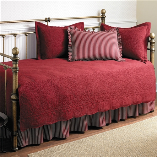 This Twin size 5-Piece Daybed Cover Ensemble Quilt Set in Scarlet Red Cotton is an elegant and stylish bed set that can provide a comprehensive makeover to the most ordinary of bedding arrangements. If a change of scenery is what you desire, then this quaint set of bedding accessories is the answer. Made entirely from 100% cotton, the Twin size 5-Piece Daybed Cover Ensemble Quilt Set in Scarlet Red Cotton flaunts a soft and plush feel without sacrificing any of the lasting durability that Stone Cottage is known for. The entire set consists of a quilt, a quilt sham to go with it, two ruffled standard shams, and a bed skirt. The bed skirt features split corners, so that it fits naturally around any corner posts that your furniture may have. The quilt is embroidered with patterns in the same shade as the parent color, keeping in line with the subtlety of this bed set. Scalloped edges define the borders of the quilt and add to its decorative capacity. The quilt sham is endowed with the same striped design as the quilt, which is something unique to these two parts of the bed set only, and provides a telling contrast to the solid shade borne by the other three. This extensive bed set is machine washable making it easy to care for. It is available in multiple colors, letting you choose one that best fits the existing room decor.