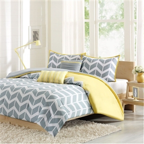 This Twin/Twin XL 4-Piece Chevron Stripes Comforter Set in Gray White Yellow makes any bedroom fun and inviting. A gray and white chevron print runs along the comforter broken up by white vertical stripes. The reverse side is yellow adding charm and color to this comforter set. The same yellow borders the matching chevron print on the two shams. Includes the matching yellow and gray decorative pillows. Made of 100% polyester peach skin on the printed side and brushed polyester on the reverse; Fill Material: Polyester; Simple gray and white chevron with dreamy yellow accent reverses to solid gray; Coordinating textured gray and embroidered yellow decorative pillows; Machine washable; 200 gram polyester fill; Style: Contemporary / Modern.