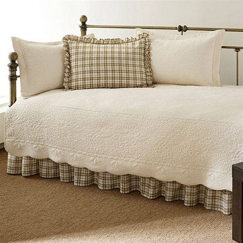 This Twin 5-Piece Daybed Quilt Set with Scalloped Edges in Ivory Cream White Beige is an elegant and stylish bed set that can provide a comprehensive makeover to the most ordinary of bedding arrangements. If a change of scenery is what you desire, then this quaint set of bedding accessories is the answer. Made entirely from 100% cotton, the Twin 5-Piece Daybed Quilt Set with Scalloped Edges in Ivory Cream White Beige in Ivory Cream White Beige Cotton flaunts a soft and plush feel without sacrificing any of the lasting durability that Stone Cottage is known for. The entire set consists of a quilt, a quilt sham to go with it, two ruffled standard shams, and a bed skirt. The bed skirt features split corners, so that it fits naturally around any corner posts that your furniture may have. The quilt is embroidered with patterns in the same shade as the parent color, keeping in line with the subtlety of this bed set. Scalloped edges define the borders of the quilt and add to its decorative capacity. The quilt sham is endowed with the same striped design as the quilt, which is something unique to these two parts of the bed set only, and provides a telling contrast to the solid shade borne by the other three. This extensive bed set is machine washable making it easy to care for. It is available in multiple colors, letting you choose one that best fits the existing room decor.
