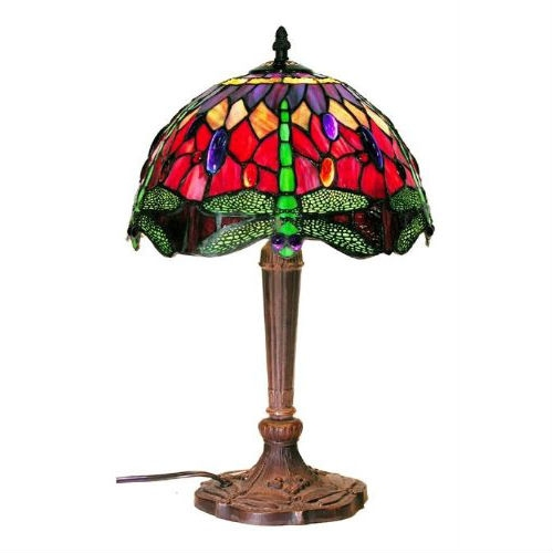 This Tiffany Style Table Lamp with Dragonfly Design Colored Glass would be a great addition to your home. The primary Colors are amber red, green and a touch of purple jewel. It has a cord switch in it.The dimensions are 12''L x 18''x 12''W. It Requires 1 bulb with a max of 60watts. It has more than 100pcs. of cut glass.Each glass is individually cut wrap around copper foil and sotterred together.