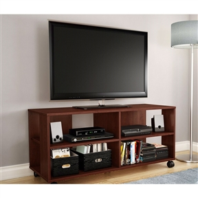 This Modern Royal Cherry Finish TV Stand with Casters Wheels is a versatile, flexible storage unit on casters that works as a combination TV stand/storage piece. The four open spaces make it ideal for putting away electronics as well as everyday items. Because of the casters, this unit is easy to move around and therefore practical and functional, no matter how it's used. The straight lines and trendy design make for a contemporary style that will go nicely with the other furniture in the room.