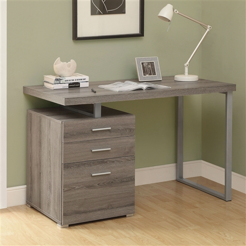 Small in scale yet big on functional and style, this Modern Left or Right Facing Home Office Computer Desk in Dark Taupe is a smart addition to your space. This desk comes in your choice of available finishes to match your style. Its work space may be configured on the left or right side to maximize functionality. It includes three generous drawers to keep you tidy.