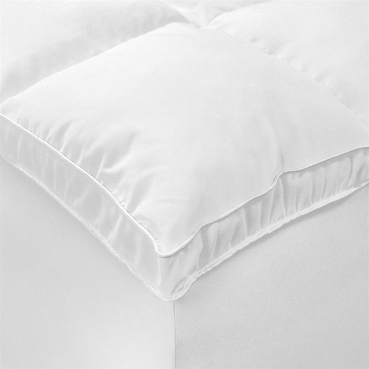 "With an ideal blend of simplicity and practicality, this Full-size Fiberbed Mattress Topper in Machine Washable Microfiber is the perfect combination of style and functionality. Its design features a box-like stitched pattern across the white colored surface. This fiber bed comes in handy whenever you want to add an extra layer of comfort to your mattress. This fiber bed is hypoallergenic, which makes it safe for use by people who are prone to allergies. This fiber bed also features an elastic-lined skirt, which ensures that the fiber bed sits firmly in its place. Fabricated from polyester, the Microfiber Fiber Bed from Ideal Comfort is durable and lasts for a long time to come. Adds an extra layer of softness to your bed; Provides extra-cushiony support to relieve pressure points, allowing you a warm and comfortable slumber night after night; Stretchy 18"" elastic-lined skirt to help keep your fiber bed in place while you sleep; Added 1.5"" gusset and a baffle box quilted construction to keep the filling from shifting."