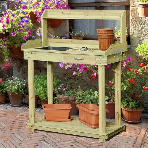 Natural Wood Potting Bench Table with Sink and Outdoor Storage Space, MBPB65181 :  Give the gift of comfort, convenience, and style to any gardening enthusiast with this Natural Wood Potting Bench Table with Sink and Outdoor Storage Space. This handy piece provides a great area to exercise your green thumb, with everything a gardener could want. The large main shelf provides plenty of space to work with plants and their pots, with a handy built-in pan to help keep the dirt from getting all over when potting. An smaller shelf runs above the main shelf, a great place to put your plants once your finished tending to them. A built-in shelf and hooks provide ample space to store gardening tools. All wood construction; Built in hooks on side of main shelf are great for hanging gardening tools; Country of Manufacture: China.