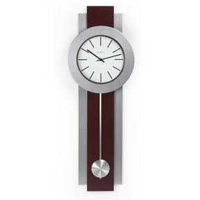 Modern Pendulum Style Wall Clock in Dark Merlot Cherry & Nickel, BHMWC1391:  This Modern Pendulum Style Wall Clock in Dark Merlot Cherry & Nickel offers a contemporary update for any setting. This stunning wall clock combines handsome resin and sleek brushed nickel for a sharp, modern look. Dark Merlot Cherry finish with nickel contrasts; Pendulum swings a total of 9 inches; Reliable quartz movement; Requires 2 AA batteries (included); International Shipping Canada; Material Resin & Brushed Nickel Movement Quartz; Shape Rectangle; Type Pendulum; Versatile style for contemporary interiors; Durable resin and brushed nickel construction; Protective acrylic lens and white acrylic face.