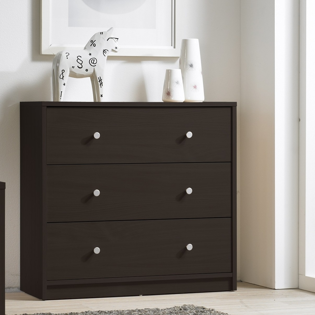This Modern 3-Drawer Chest Bedroom Bureau in Dark Brown Wood Finish would be a great addition to your home. It has a contemporary style and is easy to clean with a soft damp cloth. Made from PEFC Certified Sustainable Wood; ISTA 3A certified; Frame Material: Wood; Product Type: Standard chest (vertical).