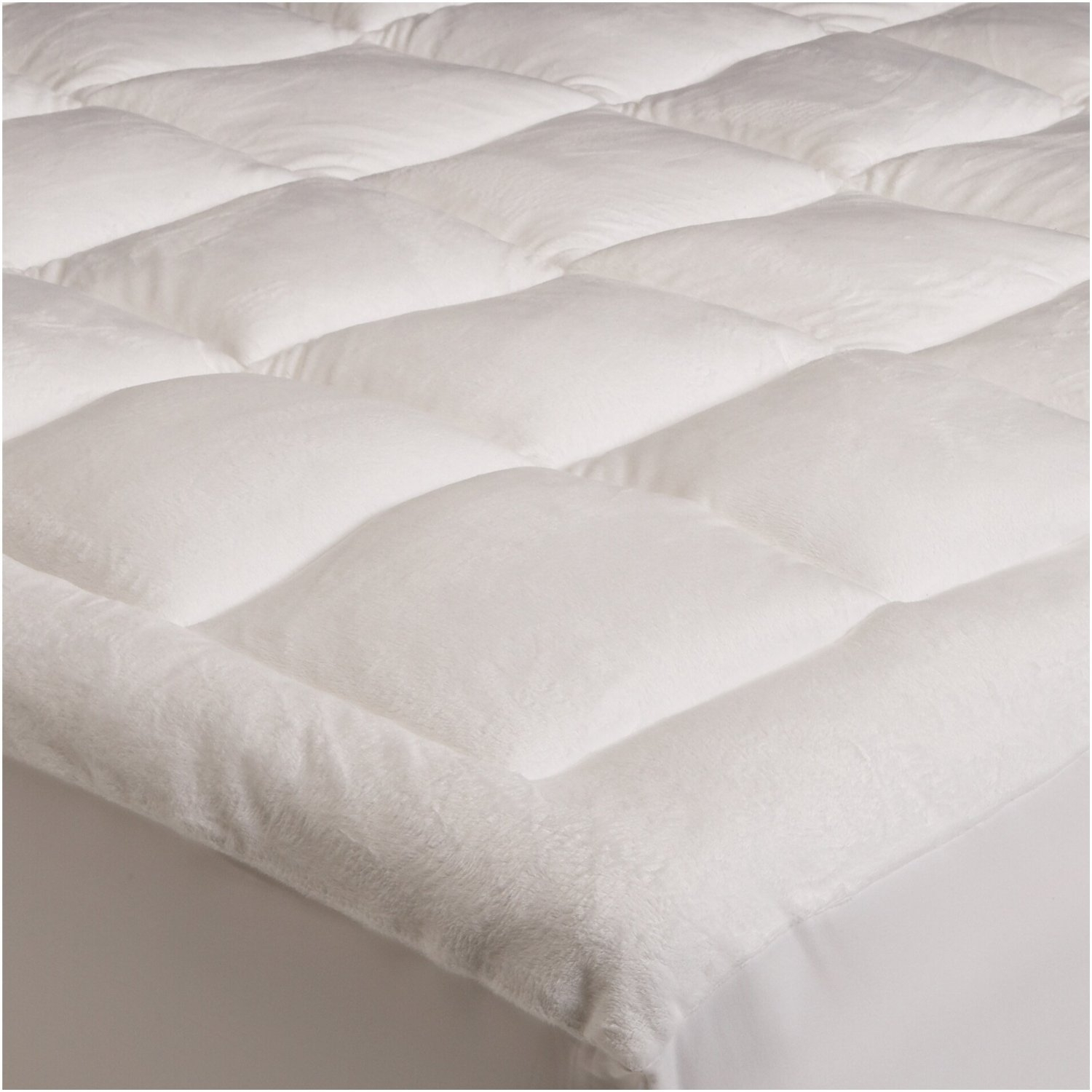 For plush comfort and support, this King size Overfilled Super Soft Microplush Mattress Pad features a blend of generous fill and super-soft fabric. Comparable to down in its softness, the pad is made from microplush fabric and stuffed with 64 ounces of loft-retaining polyester fill. An end-to-end box stitch design ensures even distribution of the fill, and mitered borders prevent shifting and flat spots. Sewn with deep pockets and a fully elasticized edge, the pad doubles as a mattress topper and a mattress protector, and it fits deep mattresses like pillow-tops. Comes in a choice of sizes for outfitting every bed in house. The King-size pad is imported and measures 78 by 80 inches. For best results we recommend professional washing/cleaning or Dry Clean Only