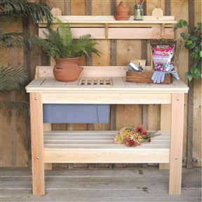 Wooden Potting Bench Garden Table - Made in USA, HWPT2949 :  This Wooden Potting Bench Garden Table - Made in USA is the dream of every gardener because of its practicality and many features that it has. Place this table on your patio, or your favorite garden spot and you can be assured that this will be the hub for most of your gardening activities. When you consider the spacious counter top with two removable inserts, and the bottom shelf, plus the top self, you will be well on your way to enjoying your gardening. Not only will your activities be organized, but you will have storage space to boot. There is a fourteen gallon heavy duty removable tote to store potting soil, and or other items you are working with. All fasteners are stainless steel which ensures no rust and longevity. Made in the U.S.A. with cypress wood, which is a renewable resource. 14 Gallon heavy duty tub; Can be easily painted or stained; Product Type: Stationary.