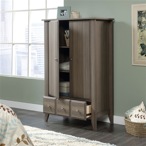 Keep your wardrobe organized and stored properly with this Bedroom Wardrobe Armoire Storage Cabinet in Ash Wood Finish. Featuring one large bottom drawer for folded items, this handsome armoire also includes two doors with two adjustable shelves inside for customizable storage. Made of particleboard, it's finished in an easy-to-match Diamond Ash. This is a classic style that suits any bedroom decor. Metal runners and safety stops; Transitional style; Assembly Required.