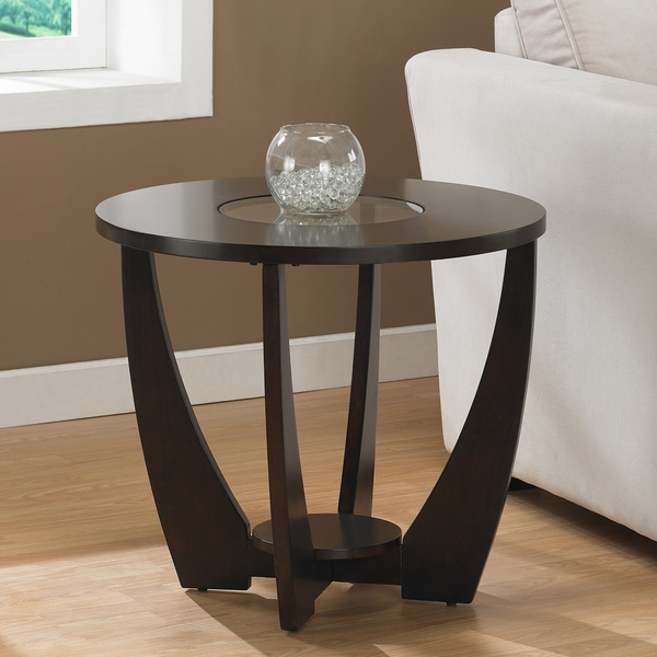 A stylish tempered glass insert and rich espresso finish highlight this Stylish Espresso End Table with Shelf and Glass Insert. This table features non-mar foot glides and a storage shelf. Solid wood legs; One (1) storage shelf; Non-mar foot glides; Assembly required.