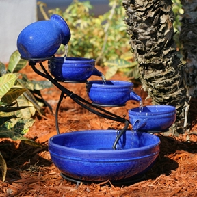 Blue Ceramic Outdoor Cascading Fountain Bird Bath with Solar Pump, BCF5618485 :  Enjoy the sights and sounds of this Blue Ceramic Outdoor Cascading Fountain Bird Bath with Solar Pump in your yard or patio. Water tumbles from one blue-glazed ceramic vessel to the next and then recycles back to the top via a hidden solar-powered pump. The solar panel can be placed up to 16 feet from the water fountain and moved to capture maximum power from the sun's rays. The bowls lift out of the weather-resistant metal frame for easy storage and maintenance. No electricity required for eco-friendly power; No plumbing - water recirculates itself; International Shipping Canada; Light No; Location Outdoor; Patio Accessories; Fountains Style Cascade; Usage Residential; Water Sound Low.