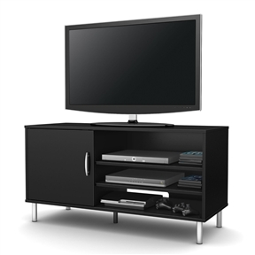 This Modern TV Stand in Black Wood Finish with Metal Legs is an affordable choice that will add a contemporary style to your décor with its simple line and metal legs in a silver finish. On the left side there are 2 closed storage spaces behind the door which comes with an elegant metal handle in a silver finish, separated by an adjustable shelf. On the right side, 3 more open storage spaces separated by 2 adjustable shelves to settle your DVD, DVR, Video Console Game, Sound bar or Home Theater. Each adjustable shelf can support a weight up to 15 lbs. It can accommodate a television up to 48 inch and its weight capacity is 80 pounds. Pair it with an Axes or City Life Bookcase to complete your living room set. It is also available in Chocolate finish. It measures 46-1/4-inch wide by 18-1/4-inch deep by 24-inch high. For complete interior dimensions, see spec sheet. It is delivered in a box measuring 56-3/4-inch by 19-1/2-inch by 4-inch high. The back is not laminated and comes with a hole for cable management. Accessories not included. Manufactured from certified Environmentally Preferred laminated particle panels. Complete assembly required by 2 adults. Tools are not included. 5-year limited warranty. Made in Mexico.