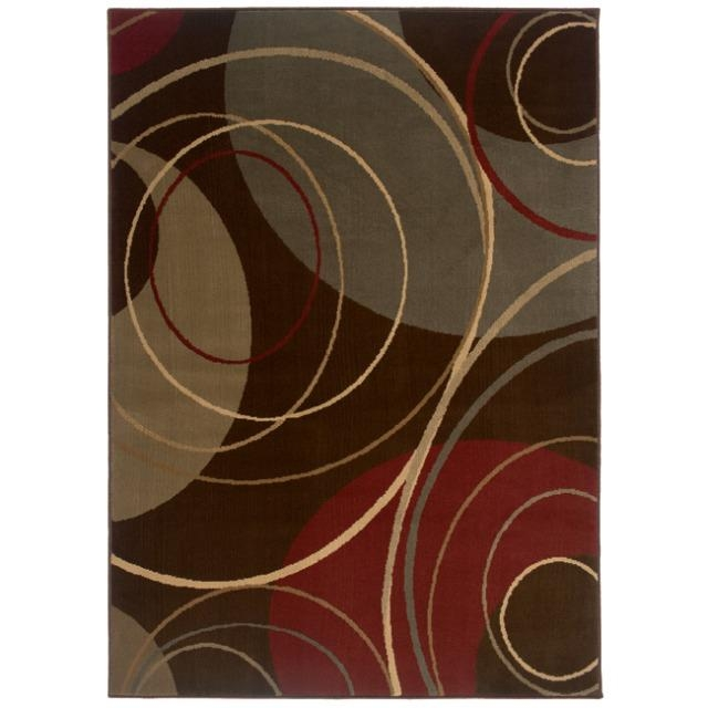 Indoor Brown Abstract Area Rug (8'2 x 10'),  IBAAR82X10 :  A unique abstract print accentuates the durable construction of this Indoor Brown Abstract Area Rug (8'2 x 10'). This rug is stain-resistant and features shades of brown, green, beige, red and ivory. All rug sizes are approximate. Due to the difference of monitor colors, some rug colors may vary slightly. We try to represent all rug colors accurately. Please refer to the text above for a description of the colors shown in the photo. Tip: We recommend the use of a non-skid pad to keep the rug in place on smooth surfaces. Pattern: Abstract; Materials: Polypropelene.