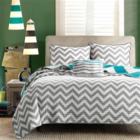 Choose your style with this Full Queen size 3-Piece Quilt Set Reversible Chevron Stripe Gray White Teal. A chic grey zig zag pattern reverses in to a vibrant aqua with ease. Made of 100% polyester, this bedding is machine-washable and ultra comfy. Available in multiple sizes, it includes the quilt, one to two pillow shams (based on the size you choose), and a decorative pillow.