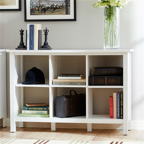 Keep favorite novels and framed family photos on this Adjustable Shelf 6-Cube Bookcase Storage Unit in White, showcasing an openwork design. Solid Wood Construction: No; Shelving Included: Yes; Shelf Material: Wood; Adjustable Shelves: Yes; Removable Shelves: Yes; Number of Shelving Tiers: 6; Shelf Weight Capacity: 30 Pounds; Shelf Weight Capacity: 50 Pounds; Wheels Included: No; Orientation: Tall; Back Panel: Open.