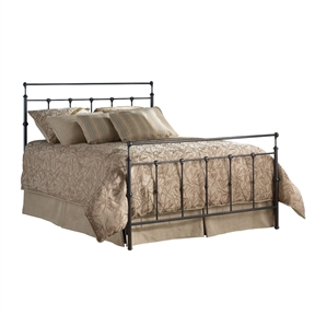 In this Queen size Metal Bed in Mahogany Gold Finish we see a purity of form that makes it the chameleon of the line. It quite effectively spans the gap between the sexes. Dressed in lace and ruffles the bed very easily carries a feminine character., while a simple change of bedding would reveal a more masculine image. Be sure to note the castings at the top of the head and footboard. The design lines of these castings move the motion in a rolling gesture up and out. This curling silhouette creates a subtle movement outward that brings plenty of interest to the design. It is this kind of attention to detail the tells us much thought went into the look and feel of this bed. The finish is Mahogany Gold.