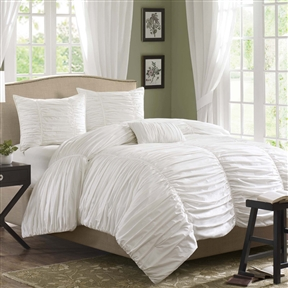This King size 4 Piece Comforter Set in Rouched White Cotton & Microsuede is where fun meets comfort. The entire top of the comforter is rouched fabric that makes it look billowy and soft while there are seams down the length of it to provide structure and give the illusion of a scalloped edge to the end of the bed. This comforter is made from 100% cotton and the reverse is a soft, brushed microsuede; making it eye-catching on the top and provide that comfortable feeling you need on the back.