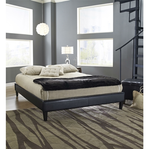 This Queen size Black Faux Leather Upholstered Platform Bed Frame with Wood Slats features a padded simulated leather to compliment any decor theme. Set includes head, foot and side rails, everything you need for the perfect platform bed. Uses a wood slats support system and they are included; Headboard Included: Yes; Style: Contemporary.