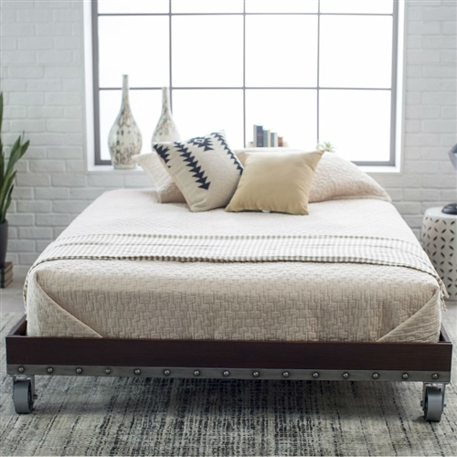 Enhance your bedroom with the rustic, industrial beauty of this Full size Heavy Duty Industrial Platform Bed Frame on Casters. This is available in your choice of size. Made of Iron, it has been hand painted to give it a realistic Walnut finish with edgy nailhead trim. It sits on casters to reiterate the industrial vibe. A walnut finish ensures this piece will suit any decor and bedding. It can function as a daybed or platform bed.
