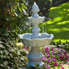 2-Tier Outdoor Fountain with Pineapple Top in Weather Resistant Resin, WGPF51895 :  A stately way to welcome guests to your garden, with this 2-Tier Outdoor Fountain with Pineapple Top in Weather Resistant Resin is topped with a stylized pineapple, which is the universal symbol for hospitality. All will be soothed into relaxation by the sounds of water falling gently and charmed by its traditional design and authentic stone look. This fountain is made of high-quality resin and fiberglass with a stone finish. It includes a durable, submersible pump that recirculates water through the fountain so it requires no plumbing to assemble is eco-friendly, too. Resin and fiberglass construction is weather-resistant; International Shipping Canada; Location Outdoor; Style Tiered; Type Floor; Usage Residential.