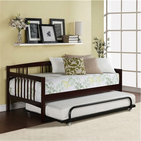 Twin size Day Bed in Espresso Wood Finish - Trundle Not Included :Product Code: EDTBDE51895 : This Twin size Day Bed in Espresso Wood Finish - Trundle Not Included is a versatile piece of furniture that can cover both seating and sleeping needs. Featuring clean lines with a beautiful finish, this daybed will blend in with most any decor. You can use it plain or dress it up with decorative pillows for an added stylish touch. Its solid wood frame makes it sturdy and durable, while the wooden slat details add a classic touch. A box spring is not required, and the mattress is sold separately. You can use this wooden daybed to provide extra sleeping accommodations for guests. It will work well in a guest room, den or in a small living space because of its compact size. The Twin size Day Bed in Espresso Wood Finish - Trundle Not Included can also accommodate a trundle or allow for extra storage space underneath.  Functional piece can be used either as a bed or as extra-deep seating; Solid wood frame; Can accommodate a trundle (sold separately) or allow for extra storage; Wooden slat details; 9 Slats; Perfect for use in a guest room or den; Full-size mattress and a trundle can fit underneath the daybed; The daybed is compatible with a twin sized mattress; Includes the twin part of the daybed; You can use a pop up trundle with this bed; Style: Traditional; Frame Material: Wood; Mattress Included: No; Daybed Weight Capacity: 225lbs.