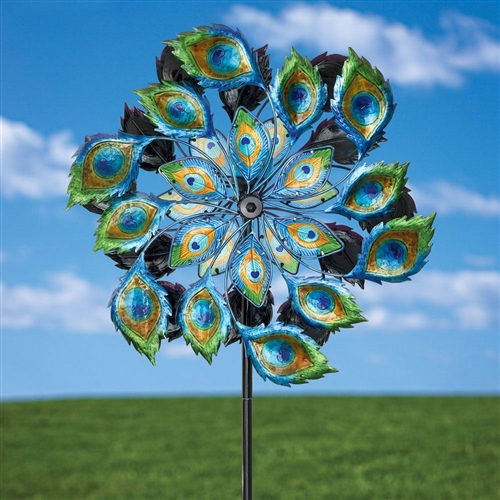 "Peacock Solar Multi-Color Wind Spinner Outdoor Lawn Garden Decor, MSWP519815 :  This Peacock Solar Multi-Color Wind Spinner Outdoor Lawn Garden Decor displays the stunning plumage of the celebrated peacock. Twelve vibrantly painted metal feathers surround the outer circumference while six translucent, colored glass feathers are in the center. Both sides spin independently in the slightest breeze. A blue glass solar powered globe sits in the center and charges throughout the day and turns on at dusk to emit a beautiful light show. Powder coated stake measures 58"" high with a 10"" fork to secure into the ground. Peacock spinner is a generous 2' in diameter. A one-of-a-kind garden statement or gift. Some assembly required."