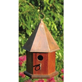 "Solid Mahogany Wood Songbird Birdhouse with Shiny Copper Roof, HCSB7746 :  This Solid Mahogany Wood Songbird Birdhouse with Shiny Copper Roof has a stylish hexagonal body of solid cypress and a six sided roof. Remove roof and clean out debris, spray with a mild bleach and water solution then rinse thoroughly and let dry in the sun. Hanging loop and matching copper perch complete the look, with easy cleanout and optional mounting; Clean outs, ventilation and drainage built in; Hand crafted in the USA; Animal Type: Wren Material; Details: Handcrafted of solid cypress; Weather Resistant Details: Weather resistant finish; Tools Needed for Assembly: Screwdriver and drill; Parts Needed: Chain or rope for hanging or screws and plate with post for mounting; Product Warranty: Lifetime. Nesting Height: 60""-72"" or higher Feet; Outdoor Use: Place in a spot with afternoon shade; Animal Capacity: Enough room for 1 family of birds; Country of Manufacture: United States."