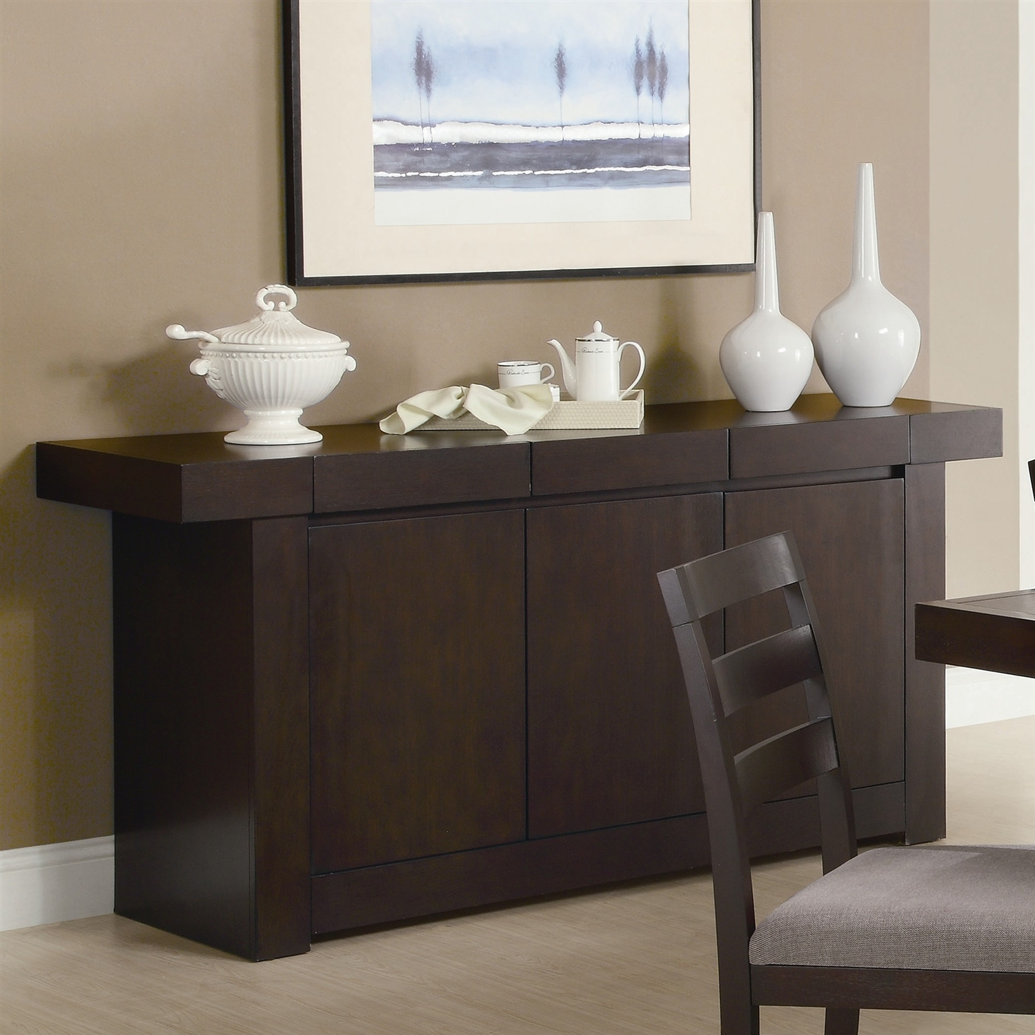 The storage drawers and space inside the cabinet doors make this Modern Dining Room Sideboard Server Table Cabinet in Cappuccino a fantastic addition to your dining room. The spacious top surface is ideal for a buffet of food for dinner guests or displaying some of your favorite accents. The ash solids and hardwoods provide a natural appeal to this server. Distressed: No; Open Storage: Yes; Drawers Included: Yes; Cabinets Included: Yes; Doors Included: Yes; Country of Manufacture: China.