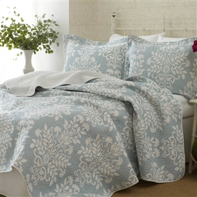 This 100% Cotton Twin size 2-Piece Quilt Set with Coverlet and Sham in Blue White Floral Pattern combines the splendor of damask with the timeless quality of quilting to create high style. The white floral damask runs in close vertical rows up a blue background. The print on the reverse offers a change of pace with a small geometric design. It's perfect as an addition to existing bedding or on its own. Gender: Female; Life Stage: Adult; Reversible: Yes; Textured: Yes; Cleaning Method: Machine washable; Country of Manufacture: China.