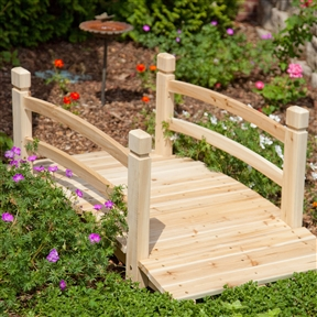 4-Ft Garden Bridge with Railings in Weather Resistant Fir Wood, GB14846151 :  Create your own garden oasis with this 4-Ft Garden Bridge with Railings in Weather Resistant Fir Wood. Whether it crosses an actual stream or one made simply of flowers, this bridge will enhance the beauty of your yard. It's crafted of beautiful fir wood that is naturally resistant to water and insects and if left untreated it will weather to a handsome silver color. This bridge has a simple design that goes with any garden theme. International Shipping Canada; Weight Capacity 600lbs.