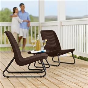 3-Piece Outdoor Patio Furniture Set in Brown Woven Rattan Resin, K3PFS9113815 : Add comfort and style to just about any area with this 3-Piece Outdoor Patio Furniture Set in Brown Woven Rattan Resin. This stunning set boasts a stylish rattan design, but it's actually made out of molded plastic. As a result, it offers superior comfort and exceptional durability. Unlike rattan, the polypropylene resin out of which this set is constructed is maintenance free, rust proof and suitable for all types of weather. When you invest in this attractive bistro set, you can rest assured that it will serve you well for a long time to come. If you're dealing with limited amounts of space, you will appreciate the compact size of this set, which includes two chairs and a small table. The rattan portion of the chairs and table is a deep, attractive brown, which is neutral enough to work anywhere. The legs of the chairs and table are made out of metal and they are exceptionally sturdy and boast sleek, simple designs. The set can be arranged however you see fit. Thanks to the manageable dimensions of the table and chairs, you can place them just about anywhere and mix and match them as needed. Traditional rattan furniture is susceptible to damage and can break easily. That's not the case with the furniture set at all. Due to the fact that it's made out of polypropylene, this set couldn't be easier to maintain. You don't have to worry about rust, so you can safely leave it outdoors in all types of weather. This set will continue to look as good as new for many years to come and it is backed up by a two-year warranty. The set arrives ready to assemble and putting it together couldn't be easier. Before you know it, you will be lounging and relaxing on one of the slightly reclined chairs and your icy cold drink will be sitting nearby on the matching table.