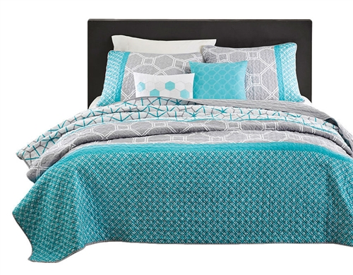 Add a bright and modern collection to your space with the Twin / Twin XL size Aqua Geometric Blue / Gray Coverlet Set. Made from polyester peach skin, the bright aqua color and geometric design bring your space to life. One matching sham features a two of the comforter designs to bring the aqua color all the way up the bed. Two decorative pillows feature hexagons to complete this geometric look.