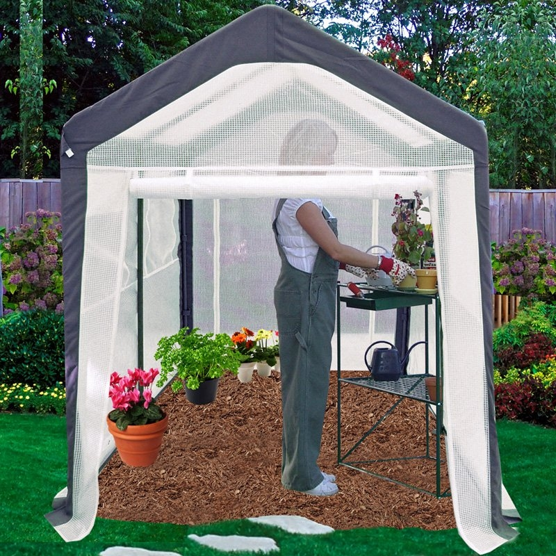 Home Gardener Portable Greenhouse (6' x 8'), SGG208491 :   Spring Home Gardener Greenhouse is lightweight and portable even after assembly. Place directly over top of your garden area to get an early start on the gardening season. Wing nut assembly does not require tools and is easy to set up. Decorative powder coat finish matches valance on cover and walls. Sturdy, rust resistant frame and translucent fabric that is UV protected gives this greenhouse a long life. Roll-up windows allow for cross ventilation and climate control and are equipped with insect netting to help control pests that can damage young plants. 6'W x 8'L x 7'H. Ground anchor system available if you like to anchor to the ground (not included, sold separately)